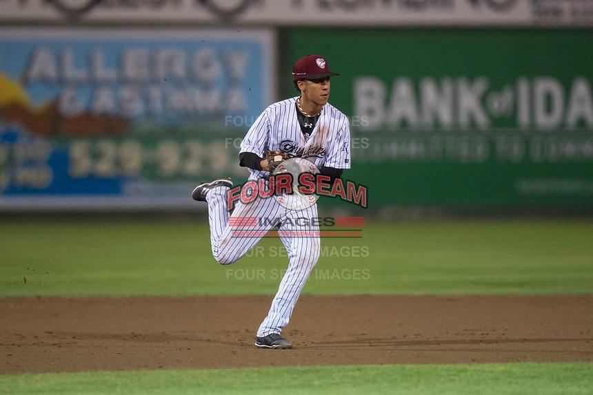 Idaho Falls Chukars shortstop Offerman Collado (0) prepares to make a throw to first base during a Pioneer League game against the Billings Mustangs at Melaleuca Field on August 22, 2018 in Idaho Falls, Idaho. The Idaho Falls Chukars defeated the Billings Mustangs by a score of 5-3. (Zachary Lucy/Four Seam Images)