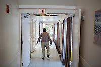 Marilyn Davidson, 70, who is high functioning and can speak, walks through the hallway of her residence.  She has lived in the Malone Park residences at the Fernald Center for 9 years, after living elsewhere on the campus before.
