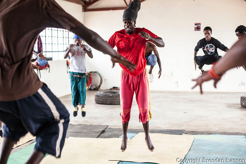 Yoga With acrobats in Kangeme Slum, Nairobi, Kenya. Acrobat troupes were  among the first to study Yoga with Paige Elenson in Nairobi as she founded Africa Yoga Project. many have since trained as teachers and teach in outreach projects in slums, prisons and special needs schools.