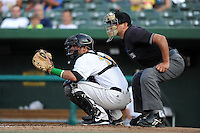 South Bend Silver Hawks catcher Roidany Aguila (24) and umpire Charlie Ramos during a game against the Bowling Green Hot Rods on August 20, 2013 at Stanley Coveleski Stadium in South Bend, Indiana.  Bowling Green defeated South Bend 3-2.  (Mike Janes/Four Seam Images)