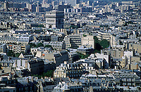City buildings with the Arc de Triomphe in the distance, Paris, France.