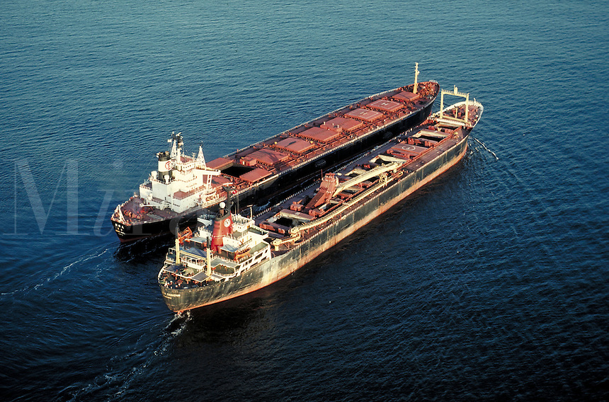 Aerial shot of supertankers transferring coal in the Gulf of Mexico. Alabama, Gulf of Mexico.