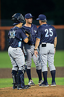 Wilmington Blue Rocks pitching coach Charlie Corbell (25) has a meeting on the mound with catcher Chase Vallot (13) and relief pitcher Jake Kalish (35) during the game against the Buies Creek Astros at Jim Perry Stadium on April 29, 2017 in Buies Creek, North Carolina.  The Astros defeated the Blue Rocks 3-0.  (Brian Westerholt/Four Seam Images)