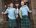 Forfar manager Dick Campbell and sons Iain (left) and Ross (right), who both play for Forfar, get their hands on the Scottish Cup ahead of their game against Falkirk.
