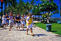 Local Hawaiian, Waianu Ahquinn, guides vacationers along the Waikiki Historic Trail telling of the significance of the Hawaiian culture in Waikiki.