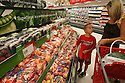 """Sarina Flores shops with her son Jeffrey, 8, at the new grocery section of the Murrieta Super Target in Murrieta, California in July, 2009. """"I'm excited the store is open,"""" she said. """"It's close to home.""""  photo for The Californian"""