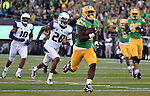 EUGENE,OR - OCTOBER 18: Running back Royce Freeman #21 of the Oregon Ducks runs for a touchdown during the first quarter of the game against the Washington Huskies at Autzen Stadium on October 18, 2014 in Eugene, Oregon. (Photo by Steve Dykes/Getty Images) *** Local Caption *** Royce Freeman