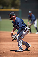 Seattle Mariners first baseman Eric Filia (15) during an Extended Spring Training game against the San Francisco Giants Orange at the San Francisco Giants Training Complex on May 28, 2018 in Scottsdale, Arizona. (Zachary Lucy/Four Seam Images)