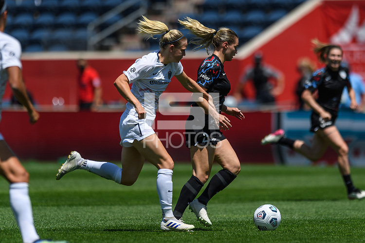 BRIDGEVIEW, IL - JUNE 5: Kealia Watt #2 of the Chicago Red Stars dribbles the ball as Diane Caldwell #7 of the North Carolina Courage defends during a game between North Carolina Courage and Chicago Red Stars at SeatGeek Stadium on June 5, 2021 in Bridgeview, Illinois.