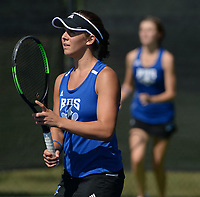 Rogers' Grace Lueders (left) and doubles partner JK Bohnert prepare for a serve Tuesday, Oct. 12, 2021, as they compete in the 6A state tennis finals at Memorial Park in Bentonville. Visit nwaonline.com/211013Daily/ for today's photo gallery.<br /> (NWA Democrat-Gazette/Andy Shupe)