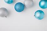 Studio shot of blue and white Christmas ornaments