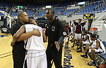 Agassi Prep Head Coach Wendell West, left, consoles Demetrius White following a last-second 69-68 loss to West Wendover in the NIAA 2A State Basketball Championship game at Lawlor Events Center, in Reno, Nev, on Saturday, Feb. 25, 2012.  .Photo by Cathleen Allison