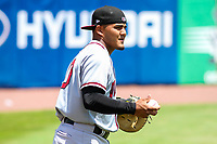 Quad Cities River Bandits catcher Ruben Castro (10) warms up in the outfield prior to a Midwest League game against the Kane County Cougars on July 1, 2018 at Northwestern Medicine Field in Geneva, Illinois. Quad Cities defeated Kane County 3-2. (Brad Krause/Four Seam Images)