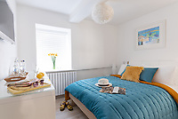 BNPS.co.uk (01202) 558833. <br /> Pic: KnightFrank/BNPS<br /> <br /> Pictured: Bedroom. <br /> <br /> The ultimate room with a view...<br /> <br /> A former fish cellar that is now an idyllic waterfront home overlooking a famous Cornish beach is on the market for £930,000.<br /> <br /> The ground floor apartment is in a prime frontline position with exceptional panoramic views over Porthmeor Beach and out to sea.<br /> <br /> Estate agent Christopher Bailey said the window in the reception space is like having your own live television screen looking out on the action of the beach.<br /> <br /> It has been designed and renovated to an exceptionally high standard and the immaculate flat is currently rented out for short holiday let, making about £40,000 profit a year.
