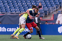 FOXBOROUGH, MA - MAY 12: Jake Rozhansky #32 of New England Revolution II dribbles as Evan Conway #11 of Union Omaha defends during a game between Union Omaha and New England Revolution II at Gillette Stadium on May 12, 2021 in Foxborough, Massachusetts.