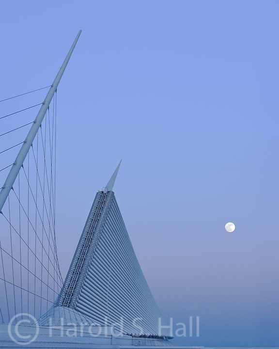 The moon rises behind the Art Museum designed by Santiago Calatrava in Milwaukee, Wisconsin.