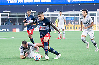 FOXBOROUGH, MA - JULY 25: Gustavo Bou #7 of New England Revolution brings the ball forward near the CF Montreal goal during a game between CF Montreal and New England Revolution at Gillette Stadium on July 25, 2021 in Foxborough, Massachusetts.