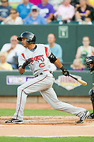 Erik Gonzalez (7) of the Carolina Mudcats follows through on his swing against the Winston-Salem Dash at BB&T Ballpark on July 25, 2013 in Winston-Salem, North Carolina.  The Mudcats defeated the Dash 5-4.  (Brian Westerholt/Four Seam Images)