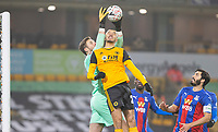 8th January 2021; Molineux Stadium, Wolverhampton, West Midlands, England; English FA Cup Football, Wolverhampton Wanderers versus Crystal Palace; Crystal Palace Goalkeeper Jack Butland reaches above Romain Saiss of Wolverhampton Wanderers  to catch the ball in his goal area