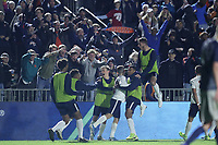 CARY, NC - DECEMBER 15: Daniel Steedman #7 of University of Virginia celebrates his goal with teammates on the bench during a game between Georgetown and Virginia at Sahlen's Stadium at WakeMed Soccer Park on December 15, 2019 in Cary, North Carolina.