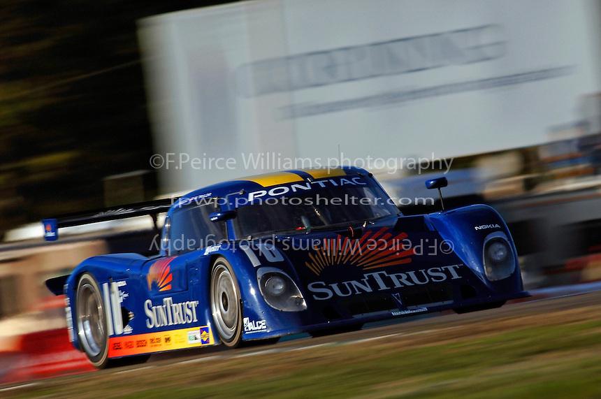 The #10 SunTrust Racing Pontiac/Dallara of Max Angelelli leads in the closing laps.