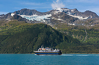 Alaska marine ferry vessel Aurora travels passage canal en route to Whittier. Chugach Mountains, Chugach National Forest, Prince William Sound, Alaska.