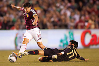 Mexico forward Carlos Vela (11) tackles Venezuela midfielder Tomas Rincon (8). The national teams of Mexico and Venezuela played to a 1-1 draw in an International friendly match at  Qualcomm stadium in San Diego, California on  March 29, 2011...