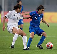 New Zealand forward (9) Amber Hearn tries to keep tight to Japanese midfielder (5) Miyuki Yanagita during first round play in the 2008 Beijing Olympics at Qinhuangdao, China. .  Japan tied New Zealand, 2-2, at Qinhuangdao Stadium.