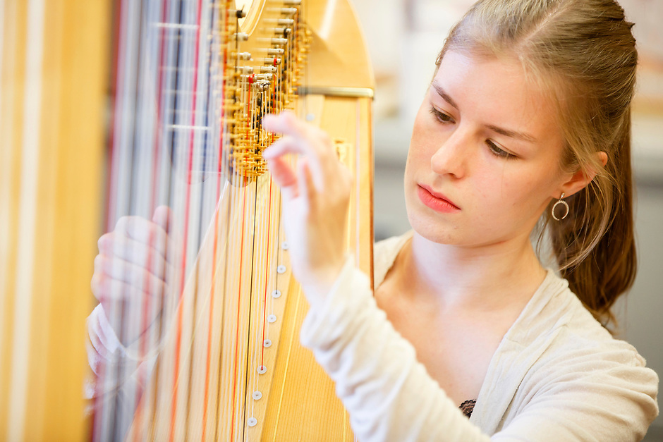 Miriam Ruf of Germany selects a harp during the 11th USA International Harp Competition at Indiana University in Bloomington, Indiana on Tuesday, July 2, 2019. (Photo by James Brosher)