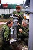 Slovakia: workers in green overalls testing a gas pipeline.
