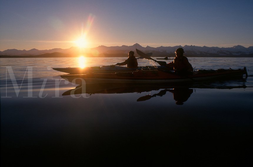 Sea kayakers paddle across Lynn Canal on a winter day