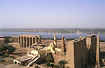 Looking over the Luxor Temple towards the West Bank of the River Nile.The 13th century Abu-al Haggag Mosque stands amid the ruins. The First Pylon of the temple complex was raised by Ramses II who ruled  Egypt from 1279-1213 BC and the Colonnade was built in the time of Amenhotep III who ruled from 1391-1353 or 1388-1351 BC.Two seated colossi of Ramses II and an 82 foot high pink granite obelisk stand at the temple gateway.The temple was dedicated to the Theban Triad of  Amun,Mut and Khonsu.The town of Luxor occupies the eastern part of a great city of antiquity which the ancient Egytians called Waset and the Greeks named Thebes.