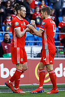 Ben Davies of Wales (R) helps Gareth Bale to adjust his captain's arm band during the UEFA EURO 2020 Qualifier match between Wales and Slovakia at the Cardiff City Stadium, Cardiff, Wales, UK. Sunday 24 March 2019