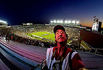 Mark Wallheiser looks for a place to set a remote camera prior the first half of an NCAA college football game against Miami in Tallahassee, Fla., Saturday, Oct. 10, 2015.   The Florida State Seminoles defeated the Miami Hurricanes 29-24.