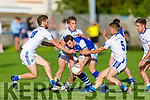 David Moran of Kerins O'Rahilly's been bottled up by Gavin Crowley, Dan Cahalane and Tom Spillane of Templenoe in the Senior Club Football championship.