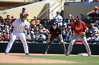 St. Louis Cardinals first baseman Xavier Scruggs (83) holds Miguel Cabrera (24) on first during a spring training game against the Detroit Tigers on March 3, 2014 at Joker Marchant Stadium in Lakeland, Florida.  Detroit defeated St. Louis 8-5.  (Mike Janes/Four Seam Images)