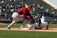 March 5, 2010:  Outfielder Ryan Raburn of the Detroit Tigers dives back to first on a pick off attempt as Geoff Blum of the Houston Astros receives the throw during a Spring Training game at Joker Marchant Stadium in Lakeland, FL.  Photo By Mike Janes/Four Seam Images