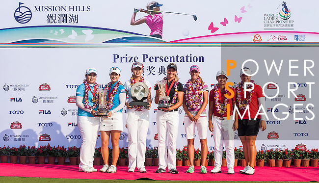 Players in action during the final day of the World Ladies Championship at the Mission Hills Haikou Sandbelt Trails course on 10 March 2013 in Hainan island, China . Photo by Manuel Queimadelos / The Power of Sport Images
