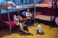 Blind and visually impaired Tibetan girl students comb their hair after waking up in the morning at the girls' dormitory of the School for the Blind in Tibet, in the capital city of Lhasa, September 2016.