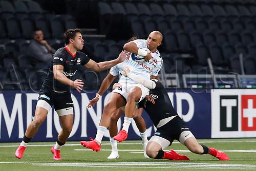 26th September 2020, Paris La Défense Arena, Paris, France; Champions Cup rugby semi-final, Racing 92 versus Saracens; Zebo (Racing 92) tackled by Daly (Saracens)