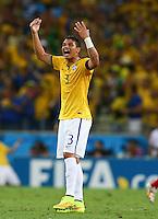 Thiago Silva of Brazil celebrates his sides second goal by David Luiz