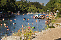 The diving board at Barton Springs Pool is a popular favorite and pastime of visitors young and old. This tourist attraction is Austin's beloved spring-fed pool maintaining a 68ºF temperature year-round with lifeguards on duty.
