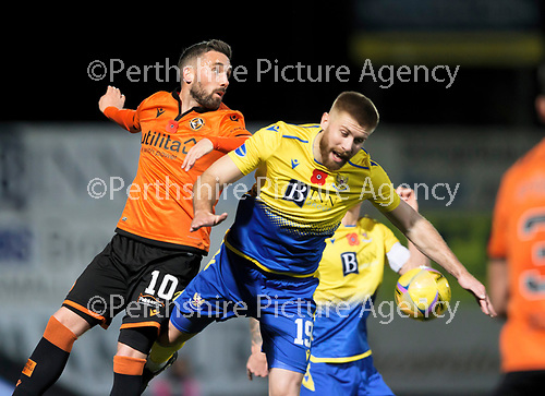 St Johnstone v Dundee United…10.11.20   McDiarmid Park      BetFred Cup<br />Nicky Clark fouls Shaun Rooney<br />Picture by Graeme Hart.<br />Copyright Perthshire Picture Agency<br />Tel: 01738 623350  Mobile: 07990 594431
