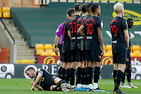 20th April 2021; Carrow Road, Norwich, Norfolk, England, English Football League Championship Football, Norwich versus Watford; Tom Cleverley of Watford lays on the pitch to prevent a low free kick