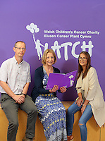Denise Henderson (C) of Children's Cancer Charity LATCH with Erin McGeough (R) and general manager of Amazon in Swansea Pat Faulkner (L), at the Children's Hospital for Wales in Cardiff, Wales, UK