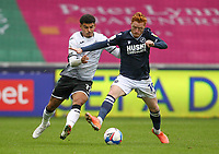 3rd October 2020; Liberty Stadium, Swansea, Glamorgan, Wales; English Football League Championship, Swansea City versus Millwall; Morgan Gibbs-White of Swansea City and Ryan Woods of Millwall jostle for possession