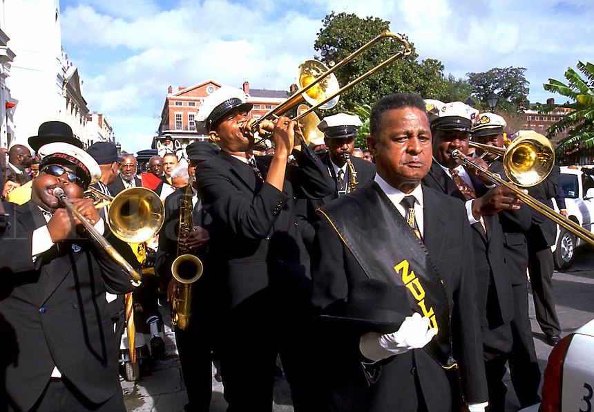 Street scene of a jazz funeral procession. New Orleans, Louisiana.