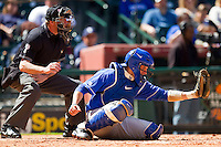 Catcher Michael Williams #35 of the Kentucky Wildcats frames a pitch as home plate umpire Doug Williams looks on during the game against the Utah Utes at Minute Maid Park on March 6, 2011 in Houston, Texas.  Photo by Brian Westerholt / Four Seam Images