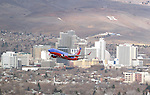 A Southwest flight takes off from the Reno-Tahoe International Airport in Reno, Nev., on Friday, Dec. 19, 2014.<br /> Photo by Cathleen Allison