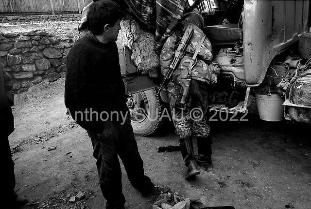"""Horag-Osh Road, Tajikistan .1996.Both cars and trucks are checked thoroughly by Russian border guards searching for hidden opium or """"hannka"""" being moved from Afghanistan through Tajikitsan and into Kyrgyzstan before heading to Europe.."""